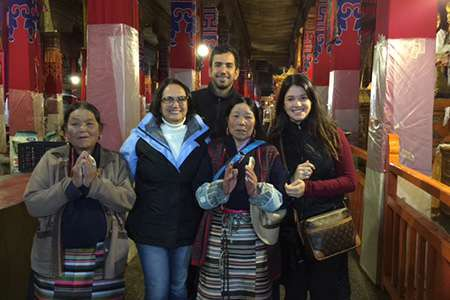 Travelers with local Tibetans in Lhasa