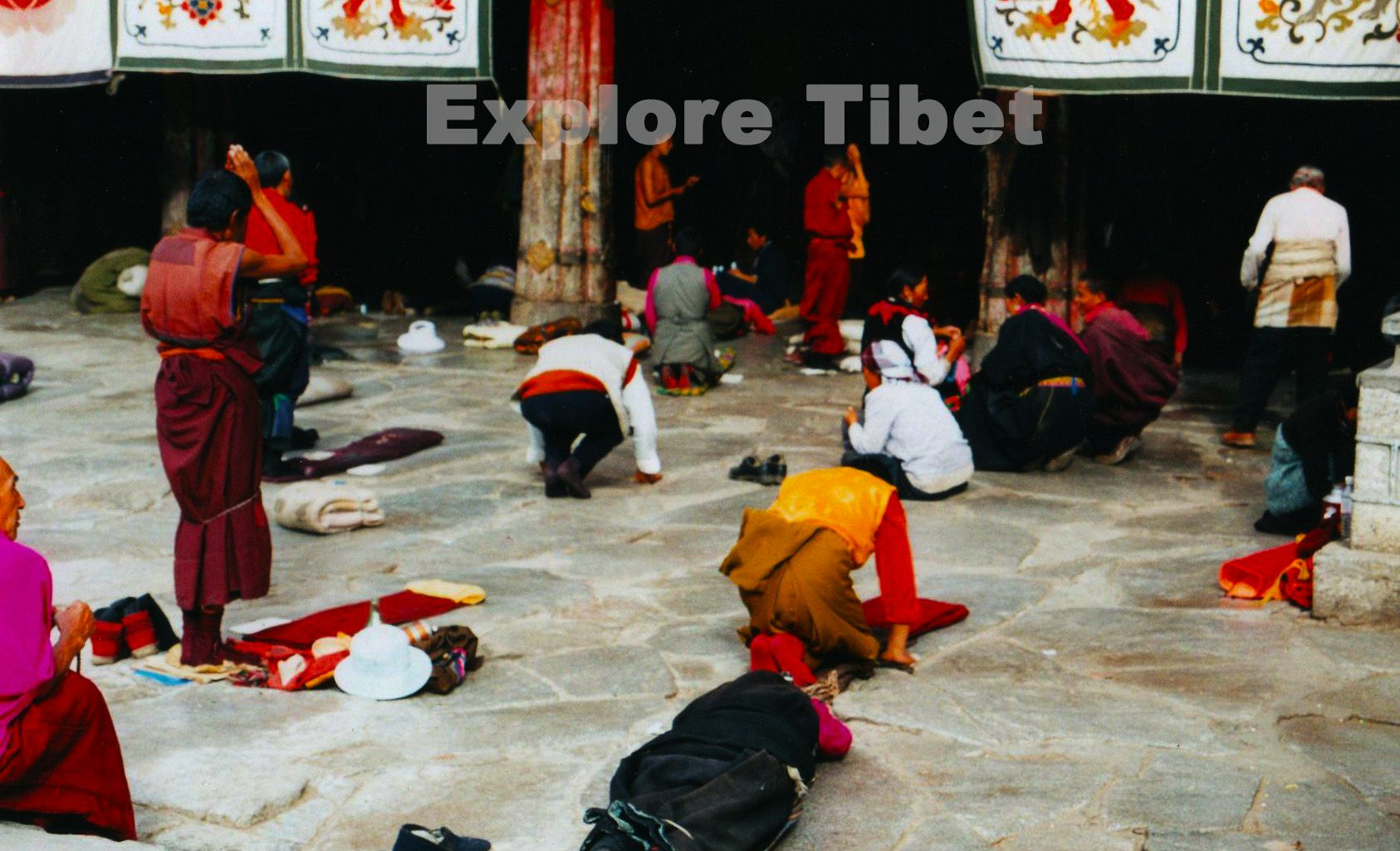 Prostrating near Jokhang Temple at Barkhor Street -Explore Tibet