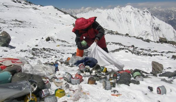 Local herder cleaning the trash on Mount Everest