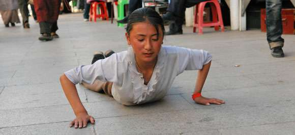 Young girl doing prostration