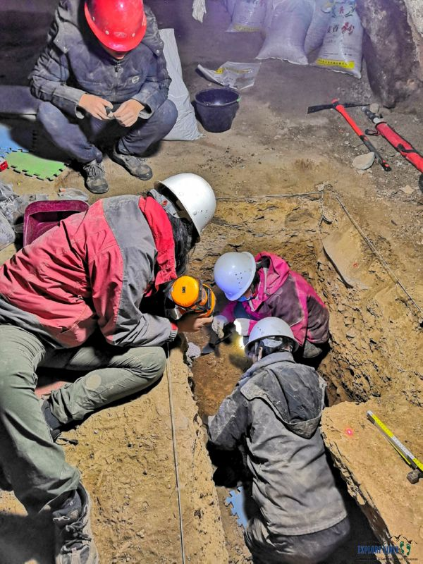 A team led by Dr. Dongju Zhang excavate the cave where the jawbone was discovered that has been traced to a mysterious human species called the Denisovans.